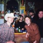 Sid, Neil Halstead and Jonathan Digby (sound engineer) after the show at the Tractor Tavern in Seattle...Dan and Sara from the tractor (friends of the Quartet....) talk behind the bar