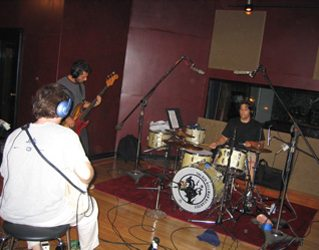 Jack, Jim, Mike during recording. Sid is off to the side in his booth. We recorded all the main parts together.