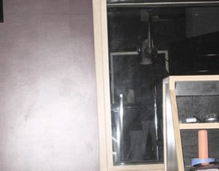 Look carefully...Sid behind the glass recording vocals.