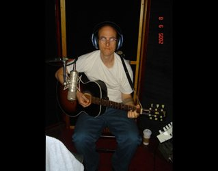Sid recording on Jim's acoustic guitar.