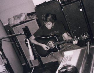 Neil trying out an idea on the acoustic.