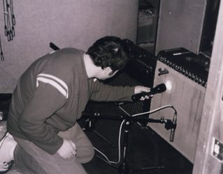 Pete checks Jack's amp for the perfect place to put the mic